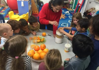 Making Orange Juice at Caring Hearts Child Care in Sunnyvale